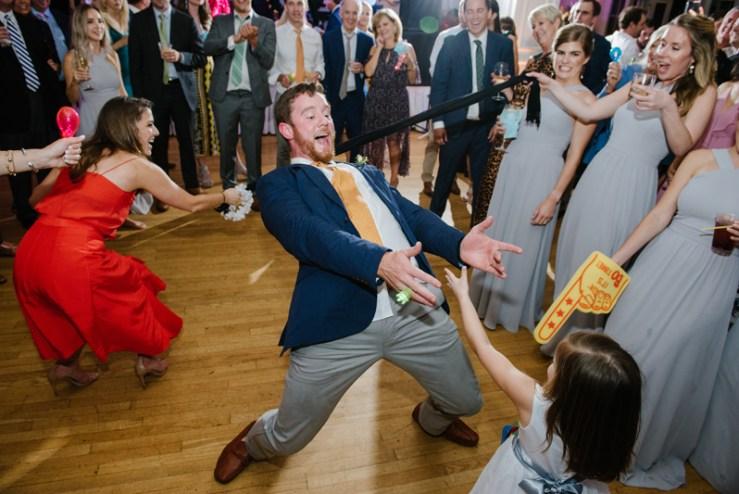 Wedding guest dancing during Roaring Gap Club wedding.