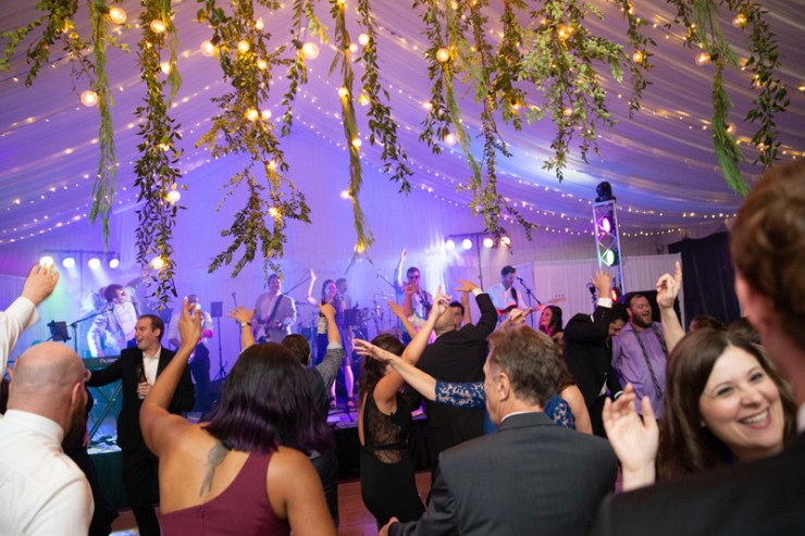 Bantum Rooster band performing in front of crowded dance floor at Biltmore wedding.