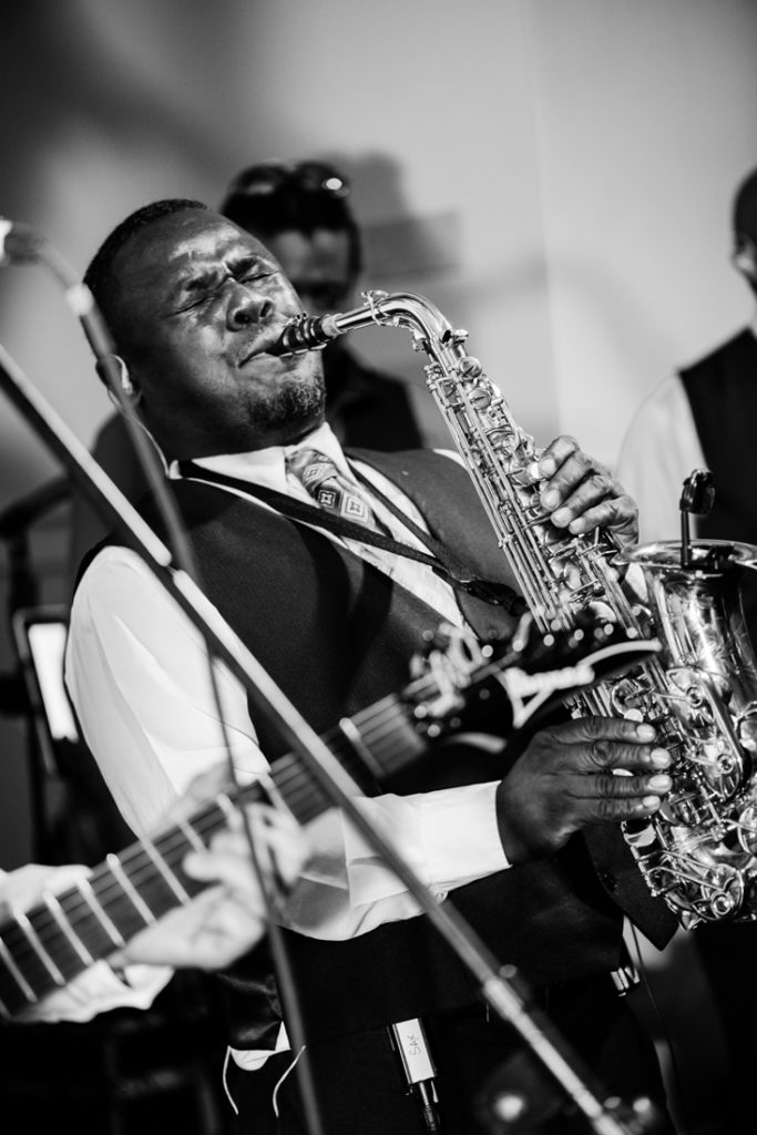 Sax player from Broadsound band performing at Bride and groom dancing The Hora at Jewish wedding at Chesapeake Bay Beach Club wedding reception.
