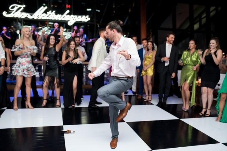 Guy dancing on black and white dance floor at Nashville wedding.