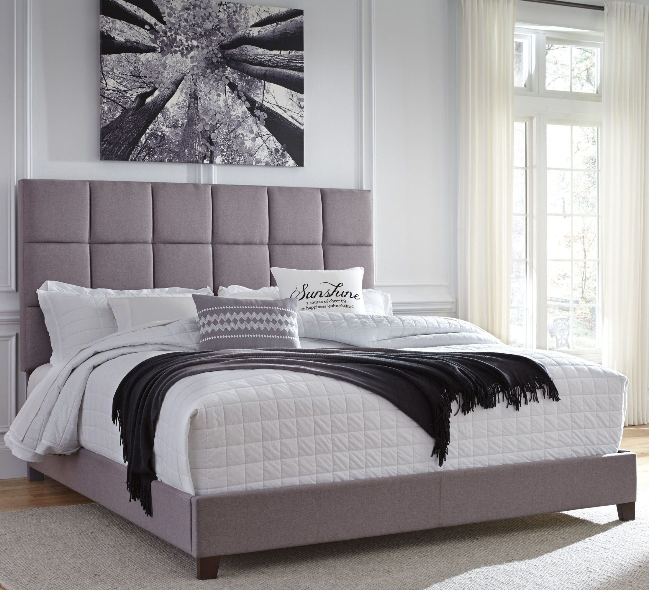 Contemporary King Upholstered Panel Bed From Ashley