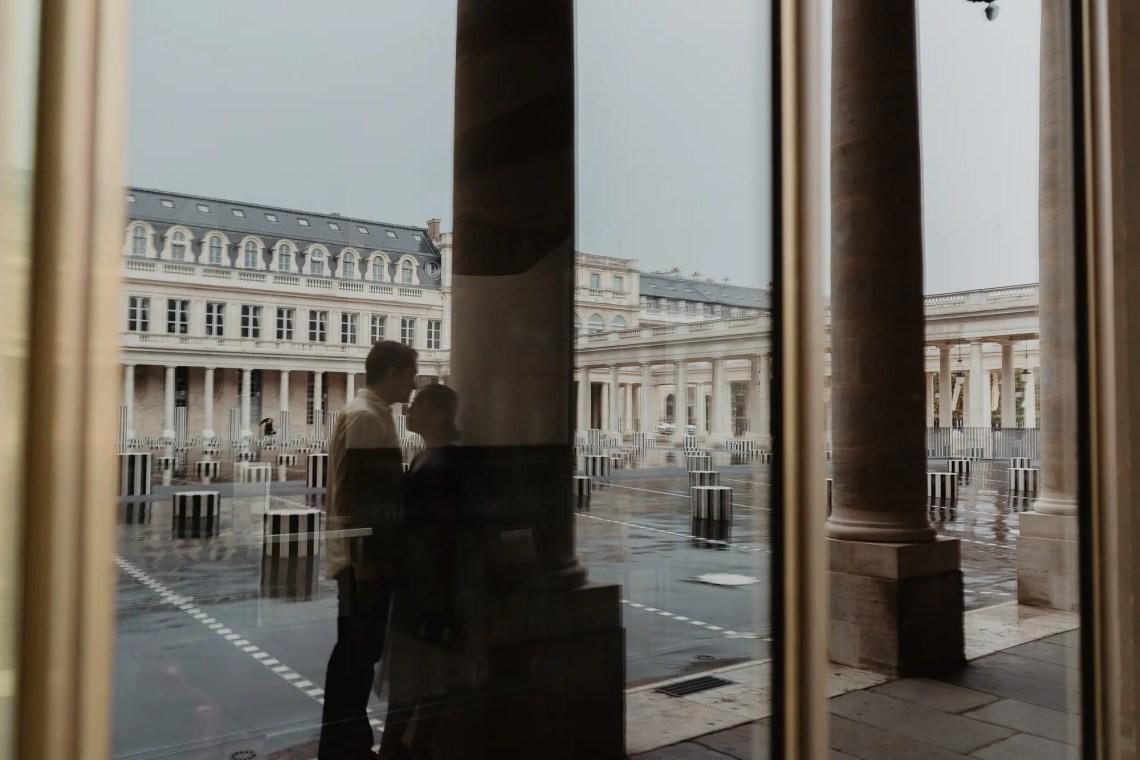 Couple reflection Palais Royal Paris