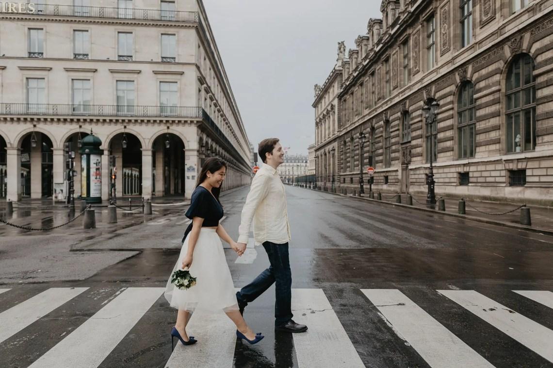 Crossing the street Louvre Paris