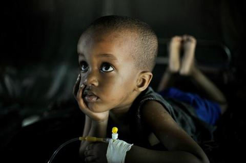 Young Mohammed suffering from Malaria recovers at an AMISOM run clinic in Mogadishu
