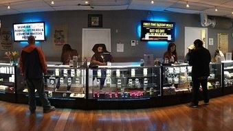 budtender Sky High Holistic Dispensary And Customers