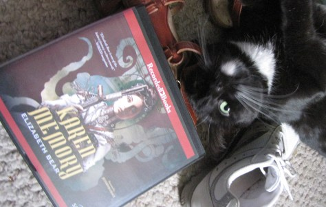 Slinky was chewing on my shoes so I gave her a book to look at.