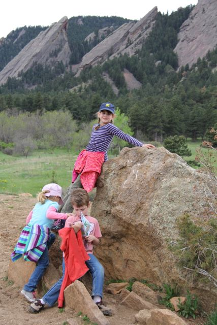 3 babies on rock off hiking trail