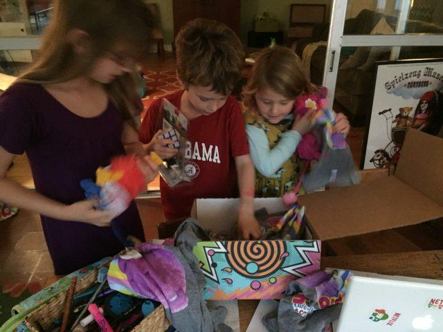 3 babies opening box