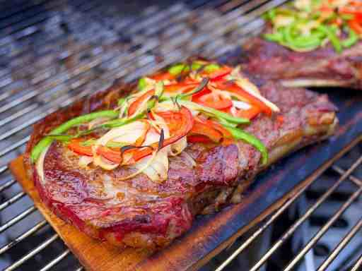Cedar Plank Grilled Ribeye with Peppers and Onions | DadCooksDinner.com