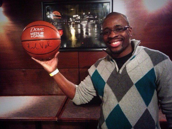 Melvin Guinn with his Dove Men + Care basketball signed by the Indiana Pacers head coach Paul Vogel.