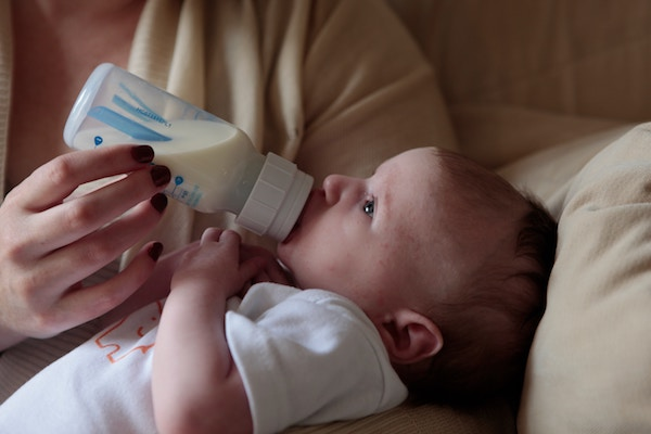Baby drinking a bottle of milk