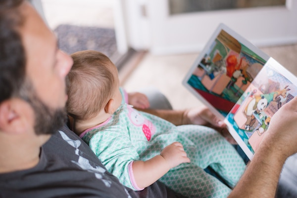 A dad reading to baby
