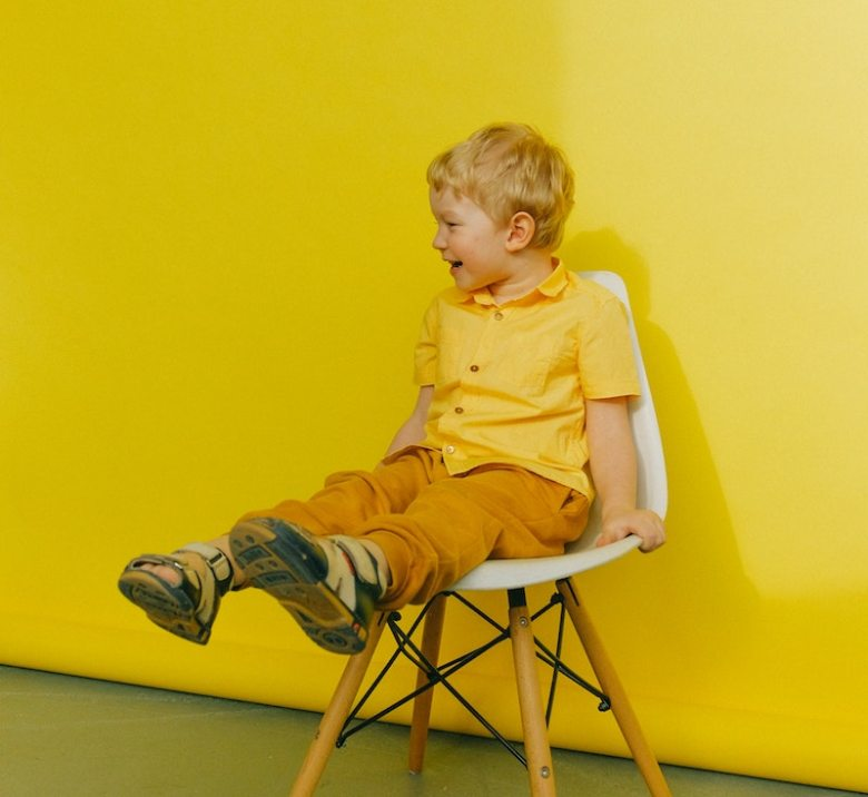 Boy in chair in yellow room