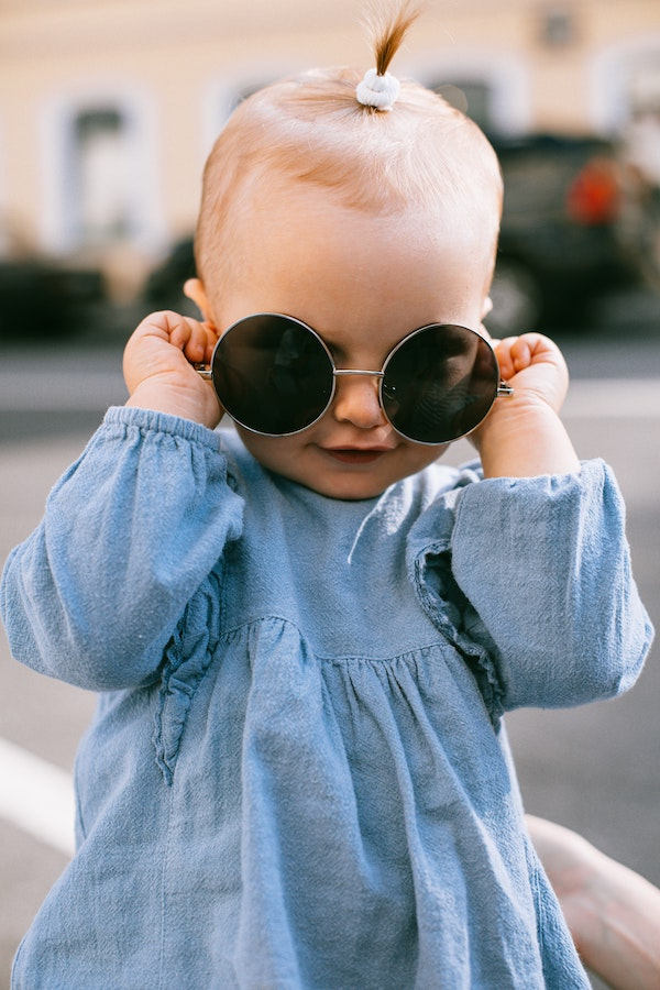Silly baby girl with sunglasses