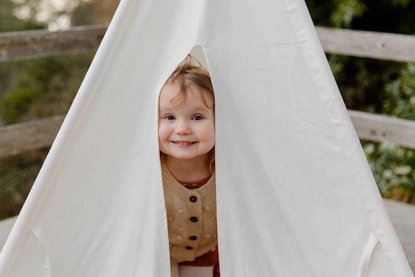 Girl peeking through tent