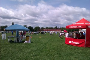 Image of exhibitor tents alongside a soccer field