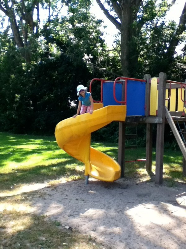 Image of a child on a playstructure