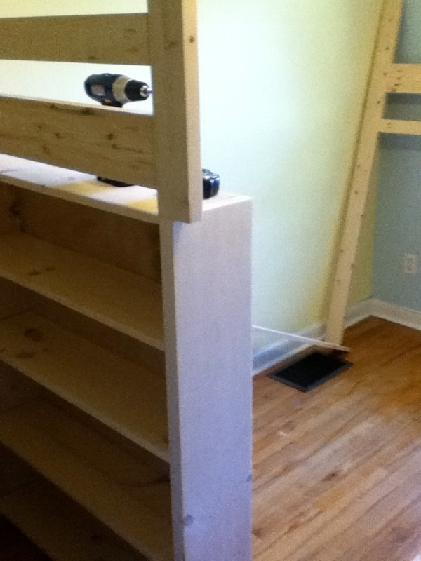 Image of the bookcase section of a loft bed. This bookcase is replacing one set of legs
