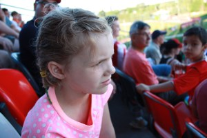 Image of a girl sitting in a stadium