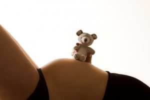 Teddy bear on top of Baby bump
