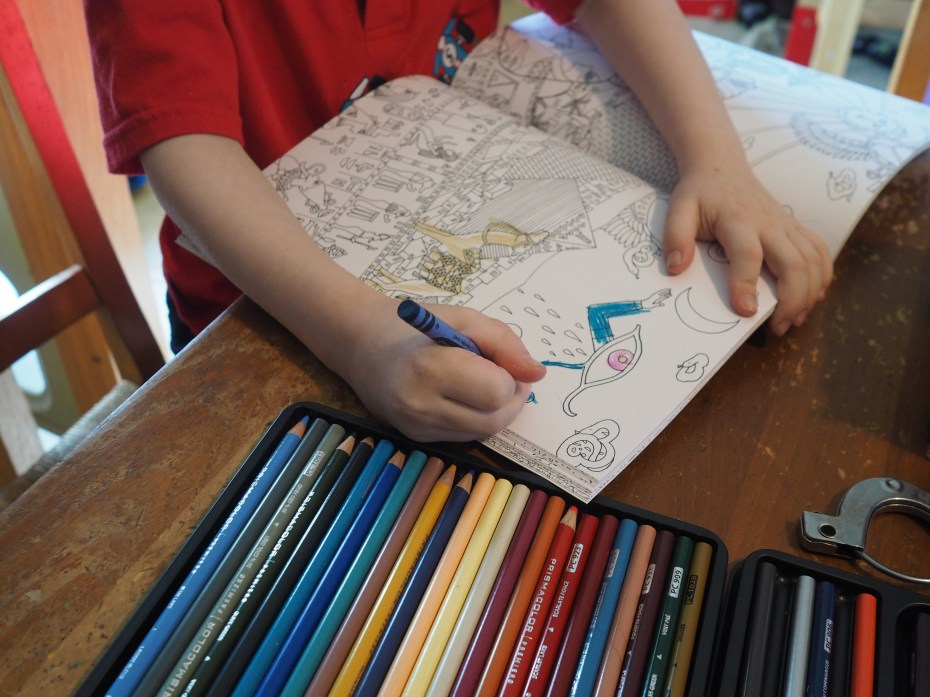 He's not usually much of a colorer, but this particular book has captured his artistic interest.