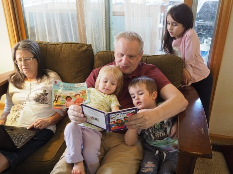 They love spending time with their Papa, and he doesn't seem to mind reading to them.