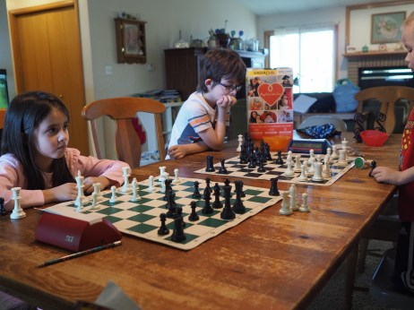 The kids have been interested in playing chess more competitively, so we've been having small family tournaments so they can practice using clocks and other tournament rules. We did this twice this week, and they had a blast!