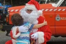 hugging Santa