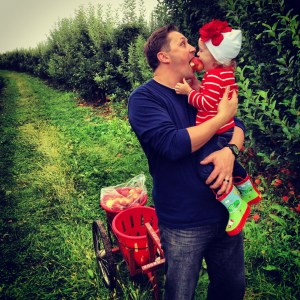 Adrian and Ava in apple orchard