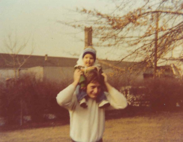 Dad holding me as a kid