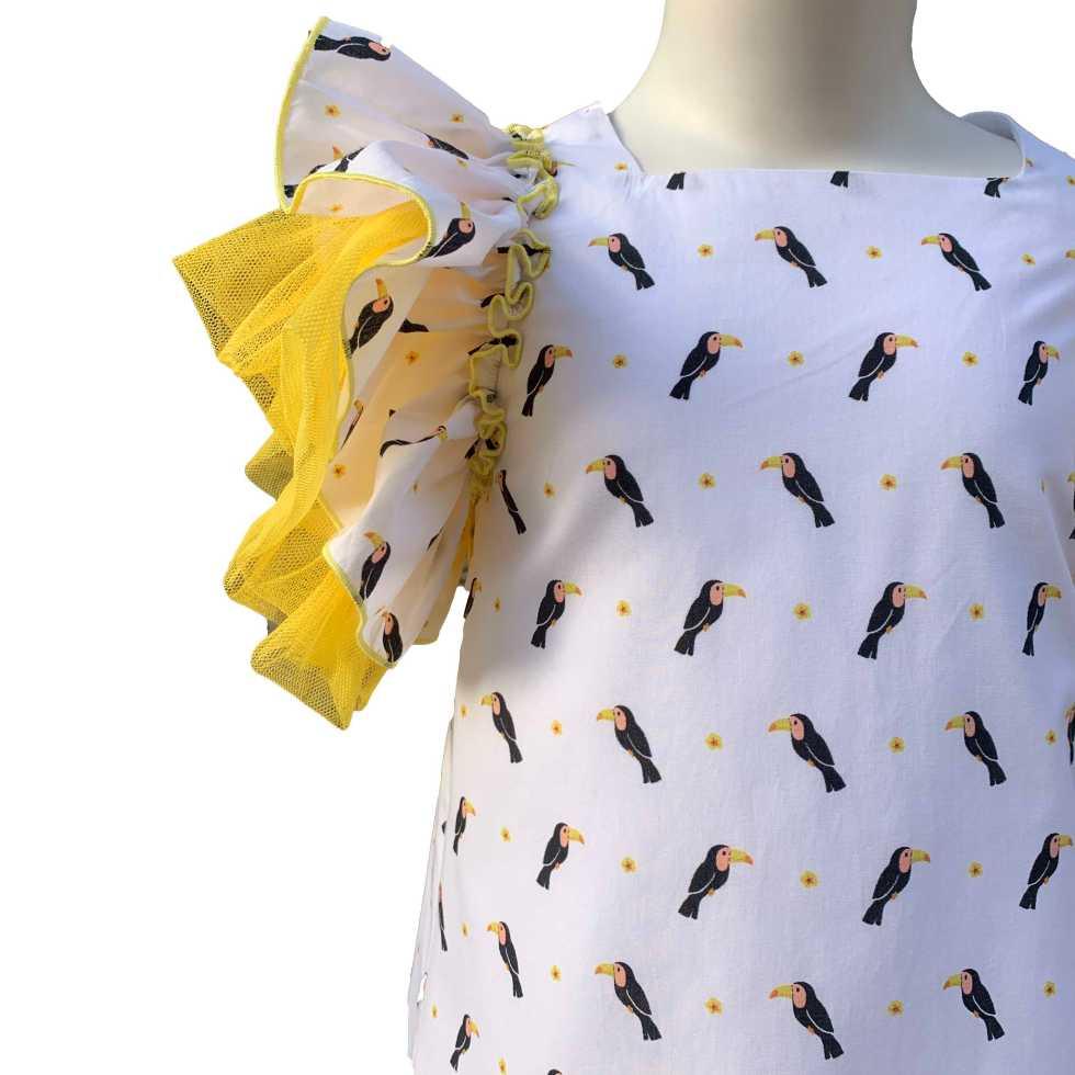 Detalle Baby Yiro vestido estampado tucanes