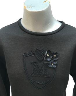 Detalle Monnalisa vestido negro neopreno