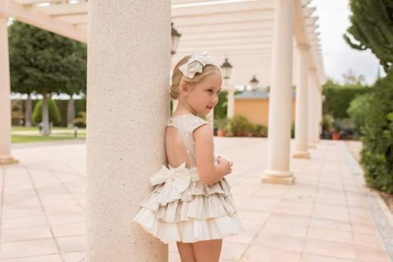 Catálogo Dolce Petit vestido lunares espalda abierta