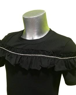 Detalle Jaimè blusa negra volante