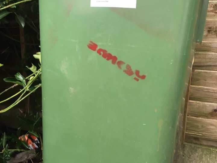 banksy tag on rubbish bin