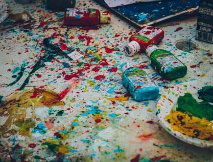 messy table with paint everywhere