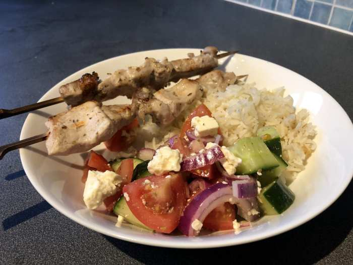 Pork souvlaki with greek salad and rice