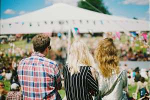 mingle with other people at summer fair