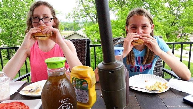 Kids enjoying the Ultimate Cheeseburger