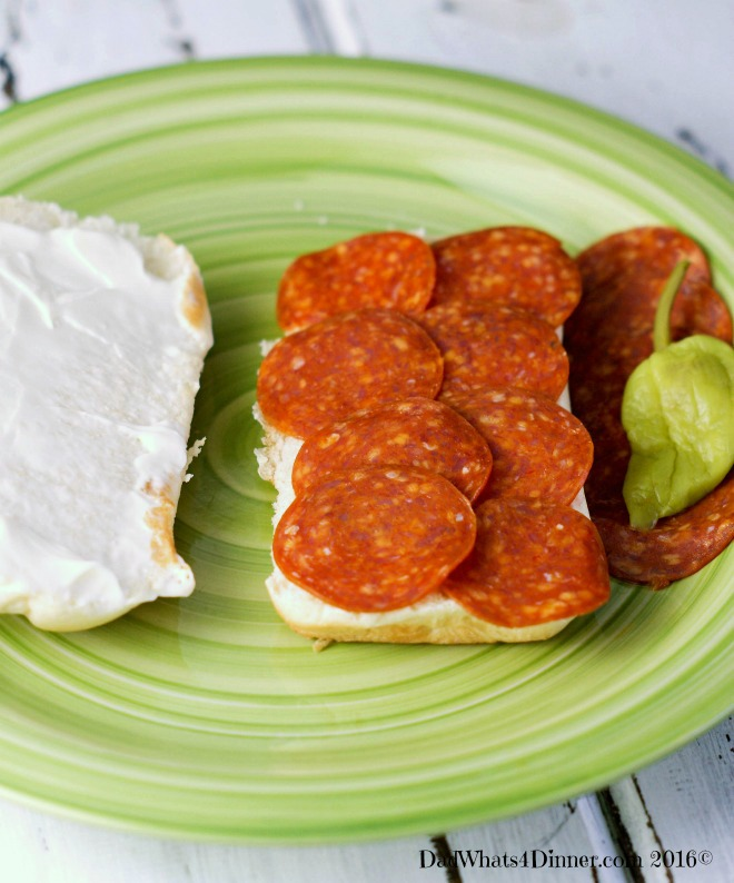 My Slow Cooker Pizza Steak Hoagies is a easy economical weeknight meal. You can feed a family of five for around ten dollars and you don't have to order from your local pizza parlor.