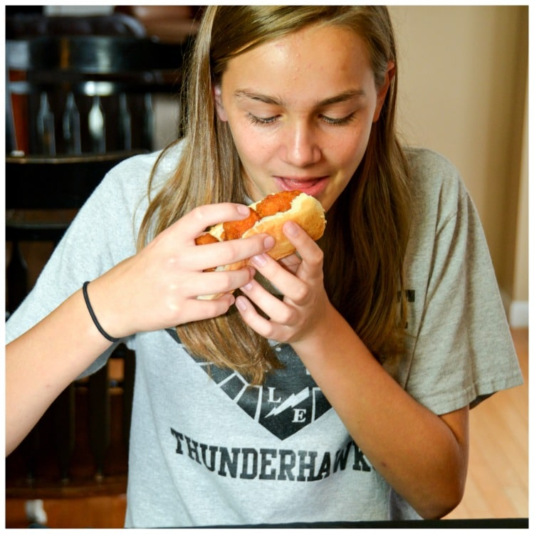 My daughter Ella trying these Boneless Honey BBQ Chicken Roll with Creamy Ranch Sauce for a quick and simple trick or treat night snack you can make with your kids.