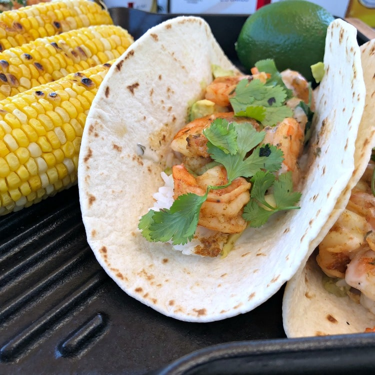 These healthy Grilled Chipotle Beer and Shrimp Tacos with avocado and rice are full of smokey spicy flavor and perfect for a light lunch when working outdoors in the summer.