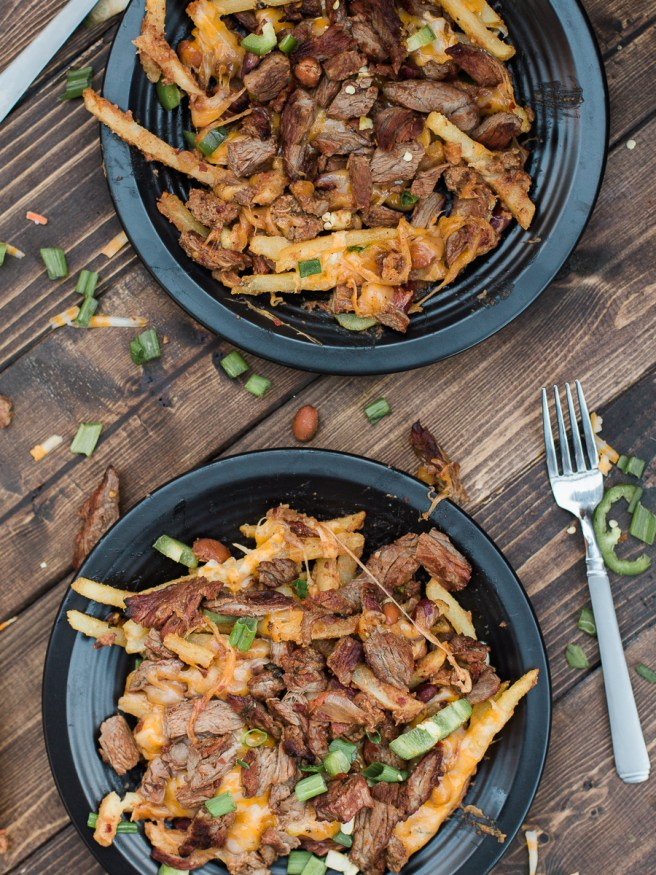 Carne Asada Fries with Chili and cheese! The best combination in the world and it's going to be a crowd pleaser. Perfect for entertaining!