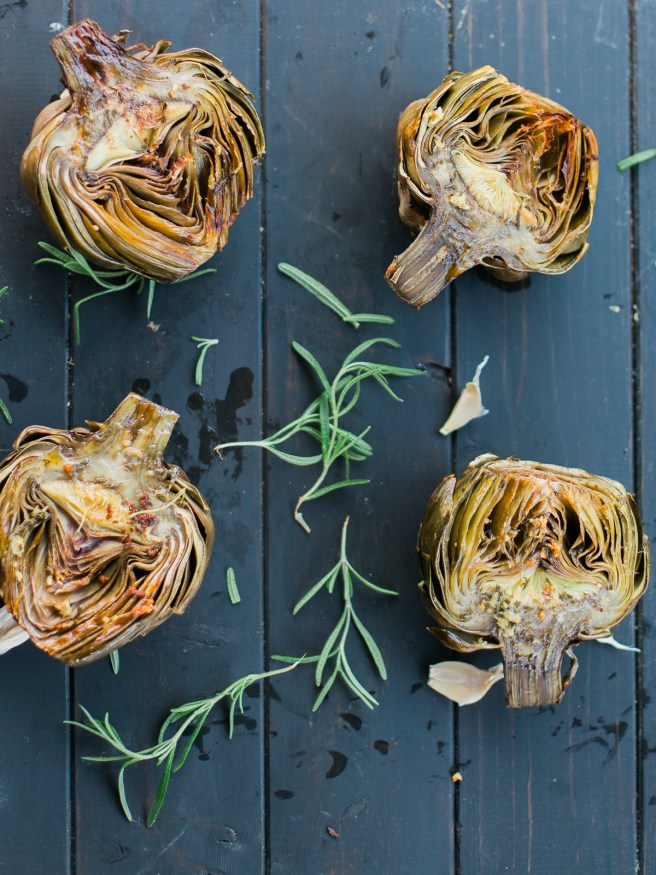 Roasted artichoke halves seasoned in a garlic and rosemary butter, the flavor is baked right in and is really amazing treat to eat as an appetizer or side!