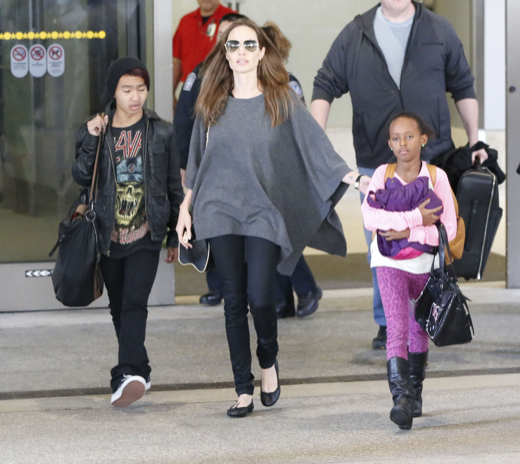Here's Angelina Jolie coming back from a shopping trip where she bought an all natural allergy relief supplement.  Hippy!