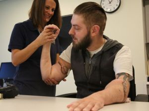 Photo credit to ABC News. Sgt. John Peck, and his wife Jessica after arm transplant.
