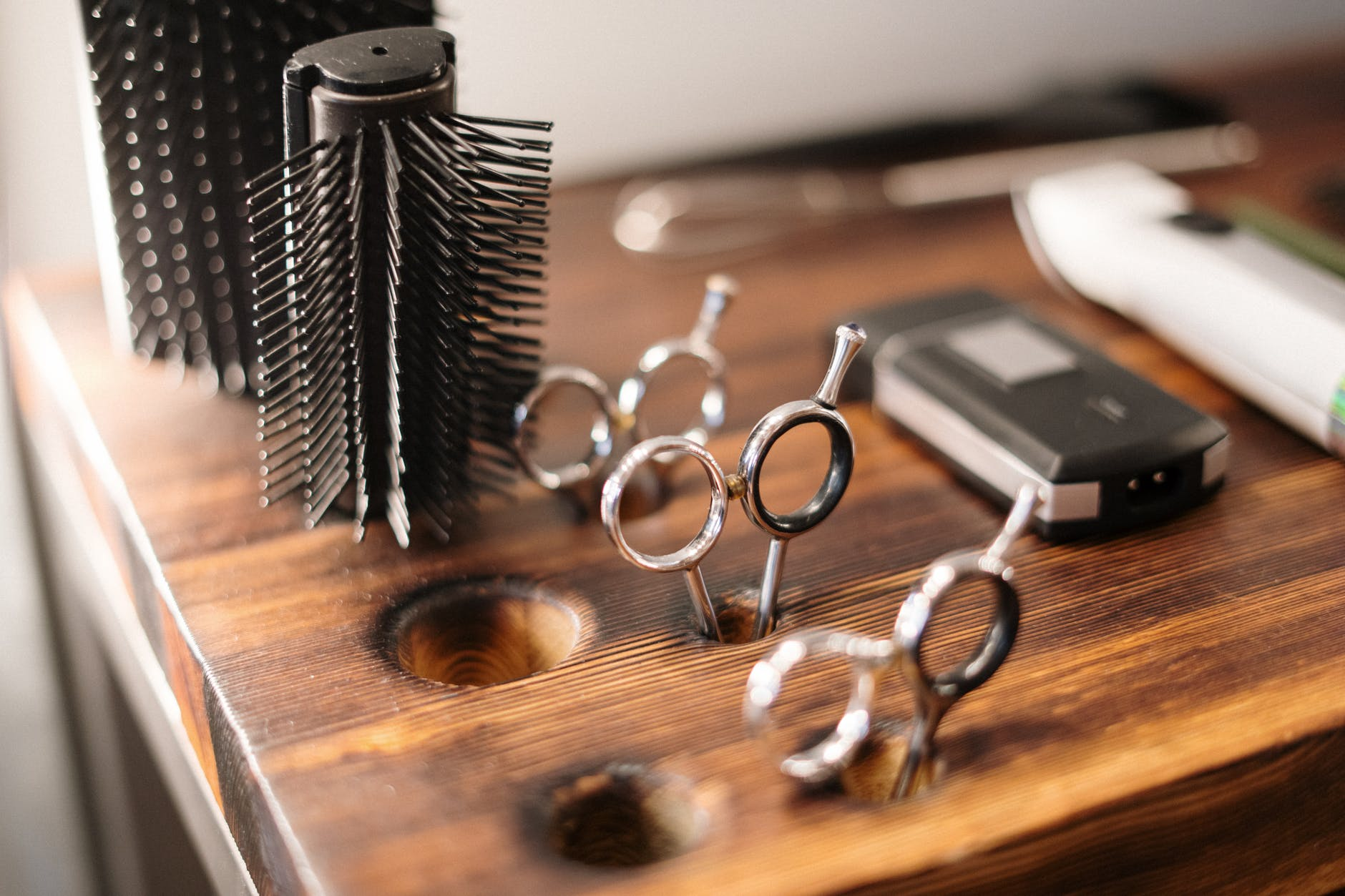 black and silver skeleton key on brown wooden table