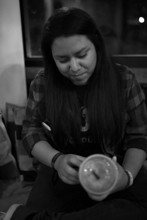 Honduras, Tegucigalpa – Yaniel, shy and focused on her smoothie