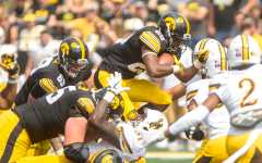 Iowa's offensive line meshing well early in the season with backs