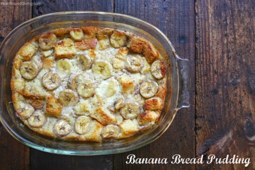 Warm banana bread pudding with a vanilla sauce drizzle.